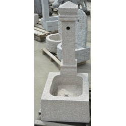 Fountain in granite column